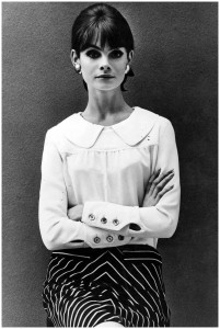 Jean Shrimpton in a peter pan collar blouse and printed skirt with signature 60s cats eye make-up